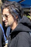 Adrien Brody shows off blue streaks in his...