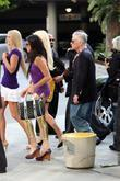 Hugh Hefner and Playmates Celebrities arrive to watch...