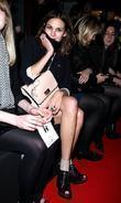 Alexa Chung, hiding her cold sore London Fashion...