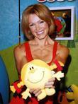 Former Glamour Model Nell Mcandrew Poses With Little Miss Sunshine At A Photocall To Unveil New Toy Range