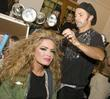 Celebrity model Cindy Taylor gets her hair done...