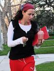 Minnie Driver, Wearing Red Puma Sweat Pants and Returning Home Carrying An Iced Beverage