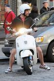 Liev Schreiber  riding on his Vespa scooter...