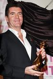 Simon Cowell and Outstanding Achievement winner