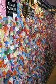 Written wishes of people on bits of colour paper at the Wishing Wall in Times Square. These will be added to the confetti that will rain down on revellers at Times Square 2009 celebration