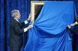 US President George W. Bush unveils his portrait at the Smithsonian National Portrait Gallery
