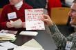A Solider Reads A Card During The Holiday Mail For Heroes Packing Event At The American Red Cross Headquarters