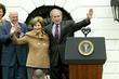 First Lady Laura Bush and President George W....
