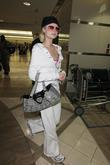 Paris Hilton, Wearing No Makeup, White Sweatsuit, Arrives On A Delta Flight From Madrid and Spain At Lax Airport