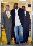 New York Giants Plaxico Burress Is In Handcuffs As He Is Led Out Of The Manhattan's 17th Precinct For Criminal Possession Of A Weapon