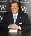 Roger Moore  signs copies of his book...