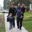 Russell Crowe, wearing a Great Britain t-shirt, holds the hand of his son Charlie, carries son Tennyson and as they stroll along a sidewalk in Beverly Hills