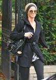 Sarah Harding of Girl's Aloud leaving her house...