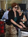 Sigourney Weaver, One Day Before Her 59th Birthday and Arrives At Lax Airport For A Flight To New York
