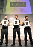 Model presents Evan Lee for auction