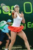 Alize Cornet plays against Jie Zheng