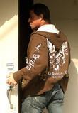 Sylvester Stallone, Wearing Tight Jeans, A Brown Hoodie and Tries To Hide From The Photographers As He Arrives At His Beverly Hills Office