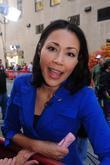 Ann Curry greets the crowd before shooting a...
