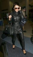 Victoria Beckham seen arriving at LAX airport, wearing...