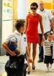 Brooklyn Beckham, Victoria Beckham and Cruz Beckham visit...