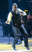 Usher performs and Usher