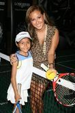 Adrienne Bailon and a young tennis player