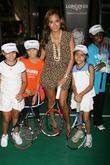 Adrienne Bailon with young tennis players Children practice...