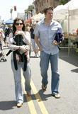 Alyson Hannigan and husband Alexis Denisof walking with...
