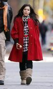America Ferrera eating an apple while filming on...