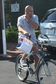 Billy Zane, Wearing Very Short Cut Off Shorts and Rides His Bicycle As He Leaves Fred Segal In West Hollywood