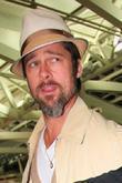 Brad Pitt and son arrive at JFK International Airport to catch a flight