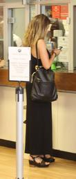 Carly Zucker checking her mobile phone as she...