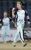 Brett Lee Of The Nsw Blues Celebrates With Team Mates After Taking The Wicket Of Rilee Rossouw