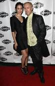Emmy Rossum and Alan Cumming