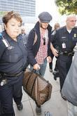David Beckham, Carrying His Louis Vuitton Travel Bag and Gets A Police Escort As He Arrives At Lax Airport On A British Airways Flight From London Heathrow