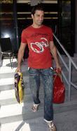 Gilles Marini leaving Ed Hardy in Culver City with a ladies red handbag