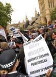 Islamic protesters greet Geert Wilders before he gives a press conference in Westminster.