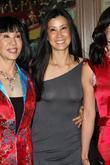 Journalists Lisa Ling (L)