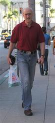 James Cromwell Carrying A Plastic Shopping Bag After Shopping At Rite Aid Pharmacy