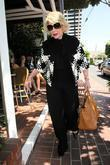 Joan Rivers, carrying a tan Hermes handbag, arrives at Fred Segal for lunch