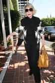 Joan Rivers, carrying a tan Hermes handbag, arrives...