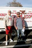 Jon Gosselin poses with 'Mr. Scoop' from a dog waste removal company