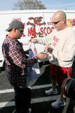 Jon Gosselin with 'Mr. Scoop' from a dog waste removal company