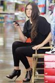 Khloe Kardashian shopping with her sister at Kitson for Kids while filming a segment for their reality TV show