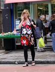 A Heavily Pregnant Kate Garraway Crossing The Street Talking On Her Mobile Phone