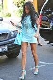 Katie Price, aka Jordan, carrying a crocodile handbag, arrives at a medical building in Beverly Hills wearing a baby blue ensemble