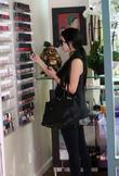 Kim Kardashian stops at a beauty salon in...