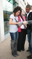 Former X Factor finalist Laura White signs autographs for fans