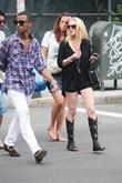 Lindsay Lohan, Wearing A Little Black Dress, Knee-high Strappy Boots and Visits Ina In Soho For A Spot Of Retail Therapy
