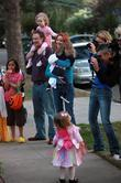 Marcia Cross, husband Tom Mahoney take their children to a local Halloween party to meet friends and their families